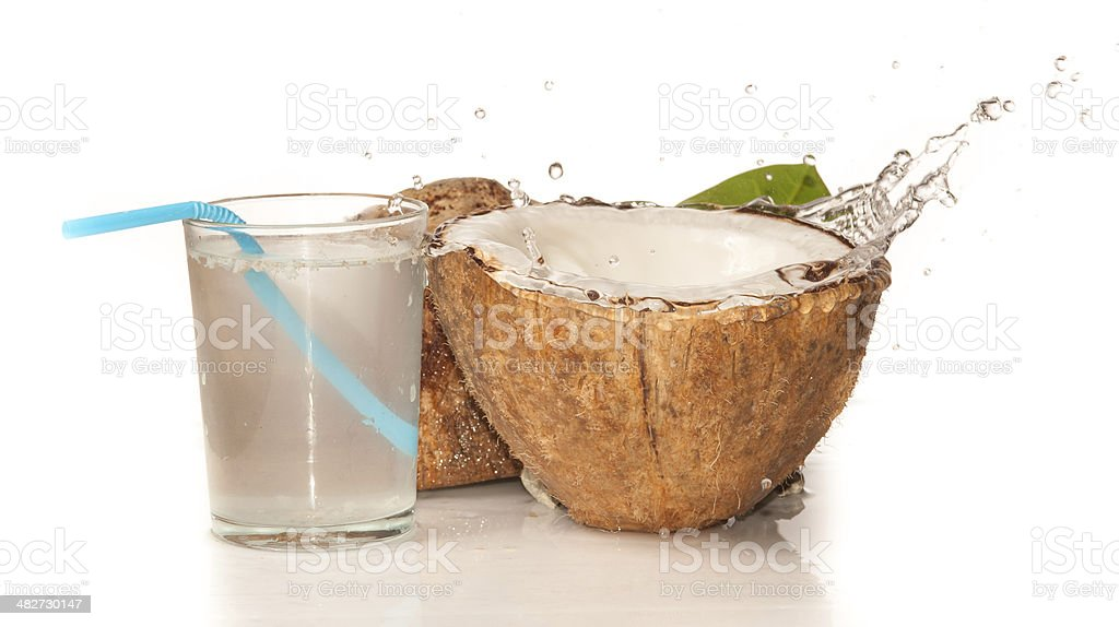 Coconut with water splash over white stock photo
