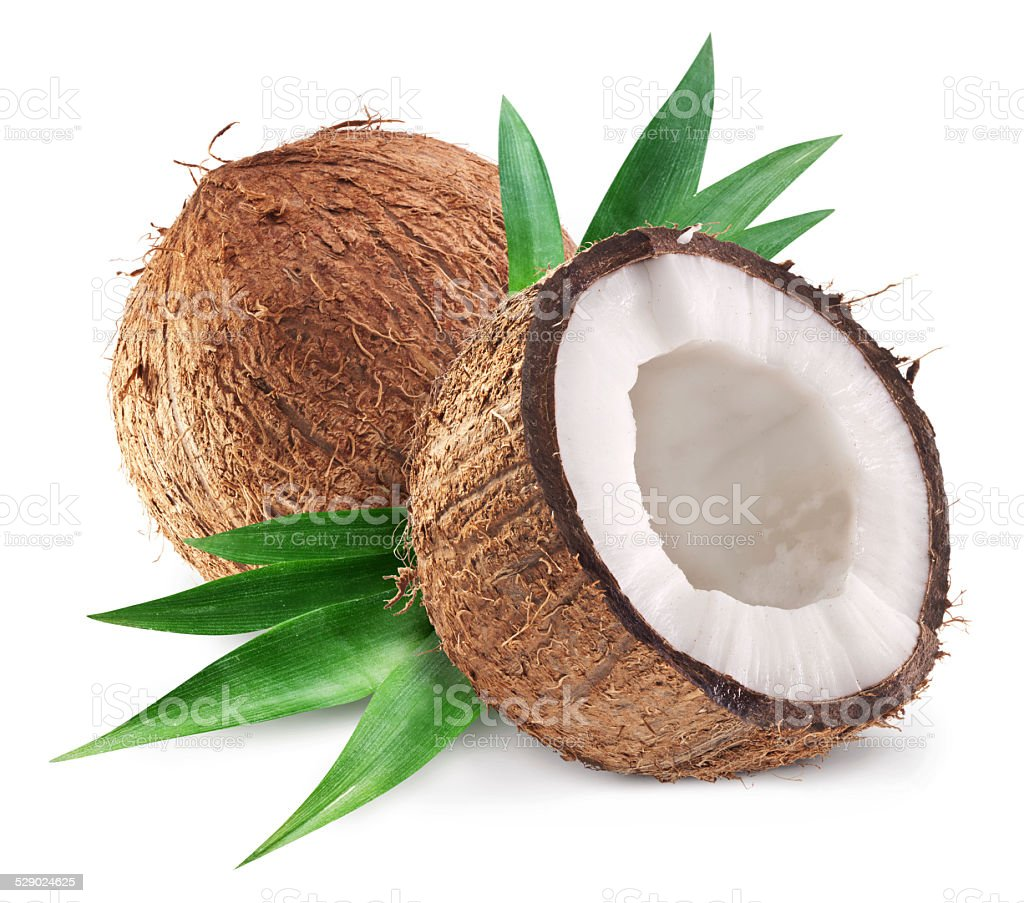 Coconuts and it's half with leaves. stock photo