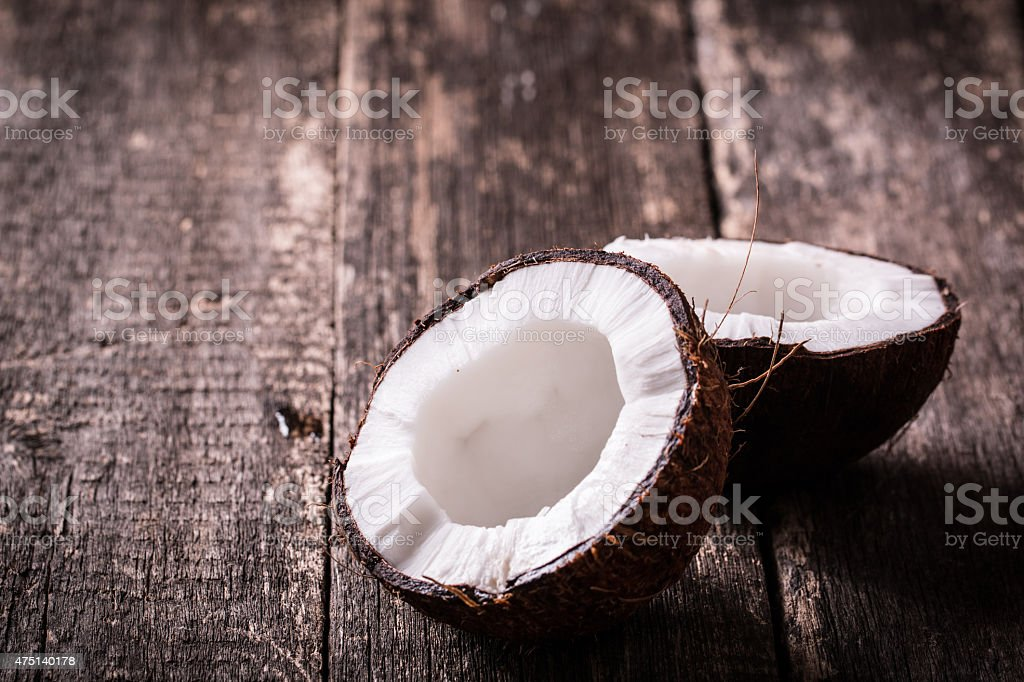 coconuts and oil on wooden table stock photo