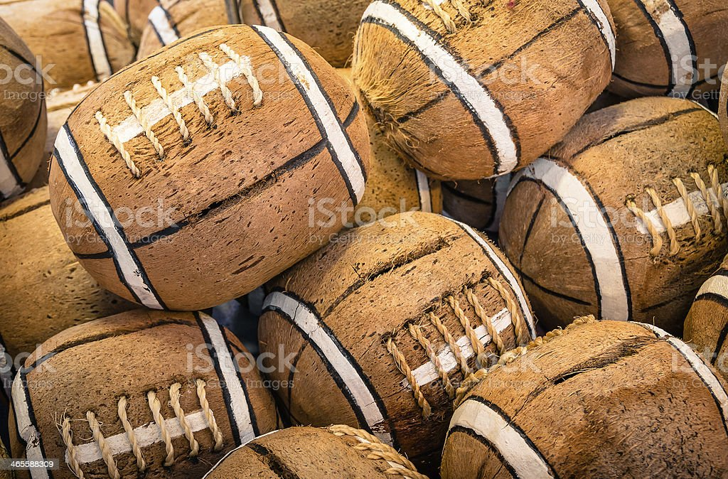 Coconuts painted as american football icons stock photo