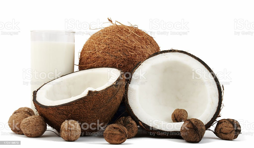 Coconuts, walnuts and milk isolated on white background royalty-free stock photo