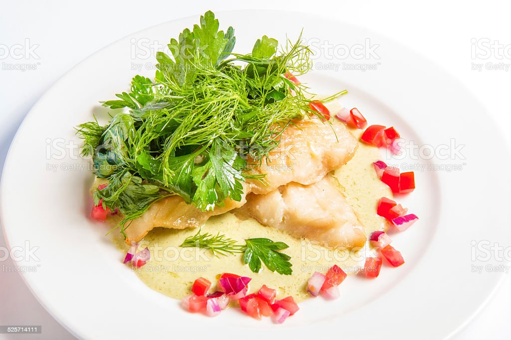 Cod baked in white wine cream sauce, cheese and broccoli stock photo