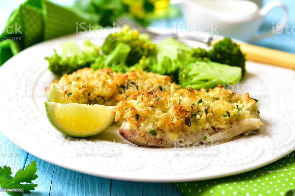 Cod baked with garlic bread crumbs. stock photo
