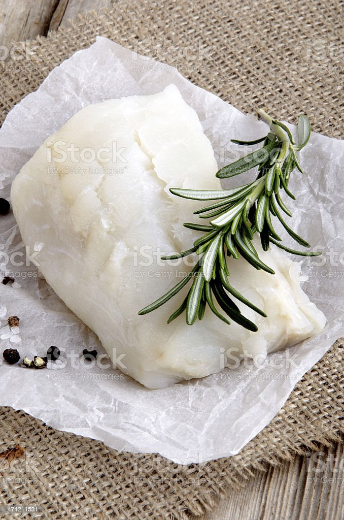 cod filled with rosemary on kitchen paper stock photo