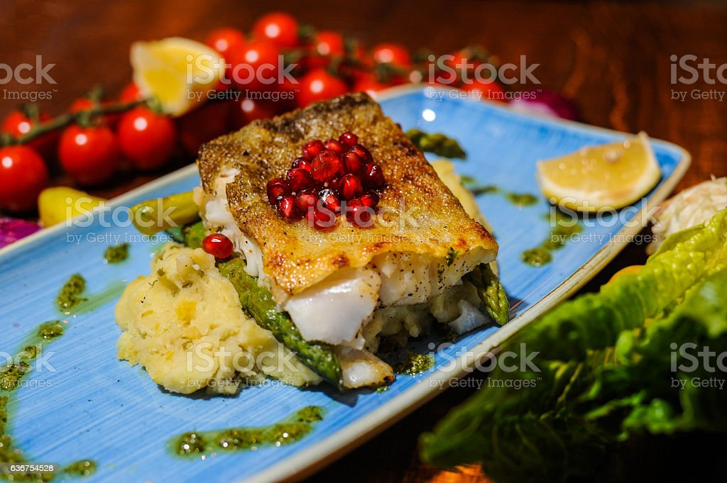 Cod fillet served with mashed potatoes stock photo