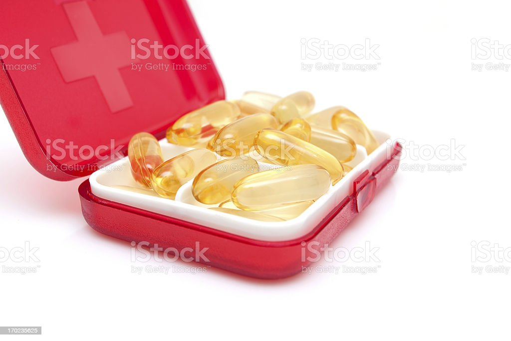 Cod liver oil capsules in Medicine box isolated on white stock photo