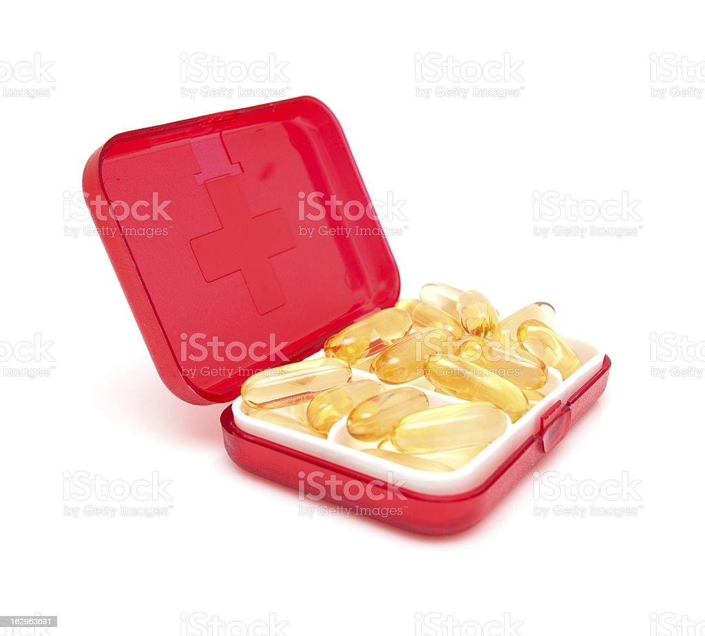 Cod liver oil capsules in Medicine box isolated stock photo