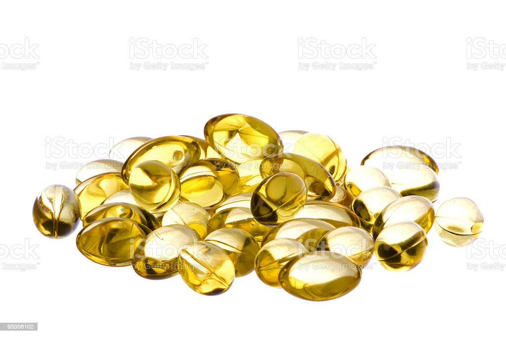 Cod Liver Oil Capsules Macro Isolated royalty-free stock photo