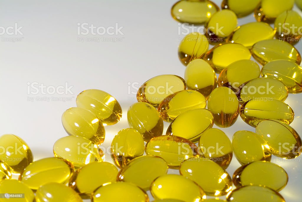Cod liver oil capules with white space to the left stock photo
