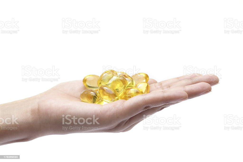 Cod liver oil pills in hand royalty-free stock photo