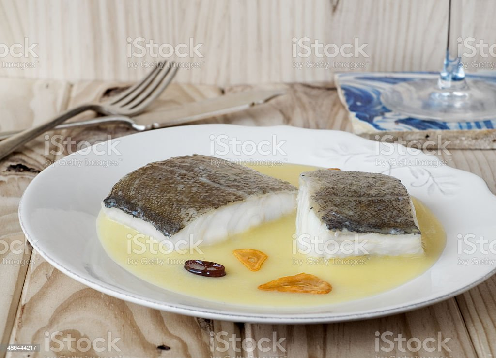 Cod with Pil Pil Sauce, Basque cookery. stock photo