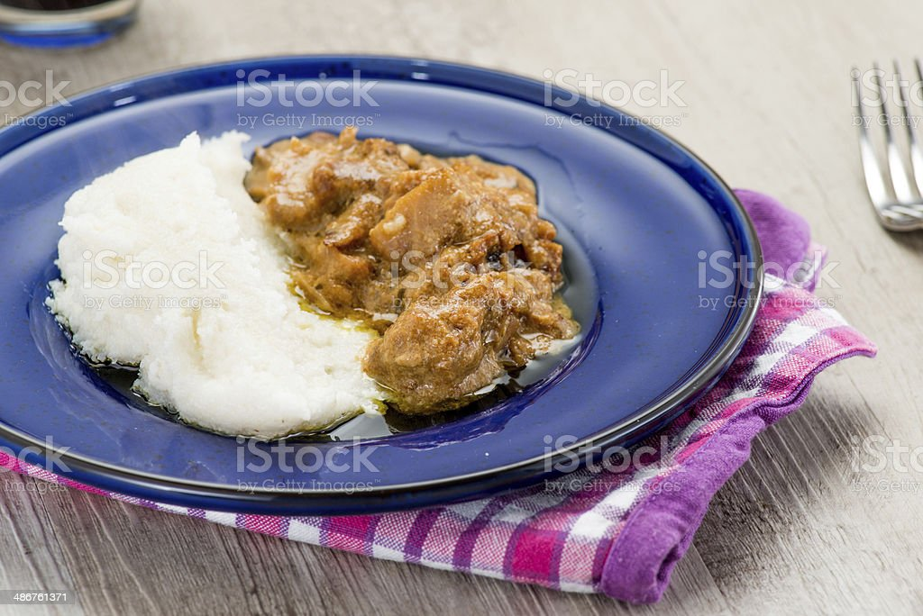 Cod with white polenta stock photo