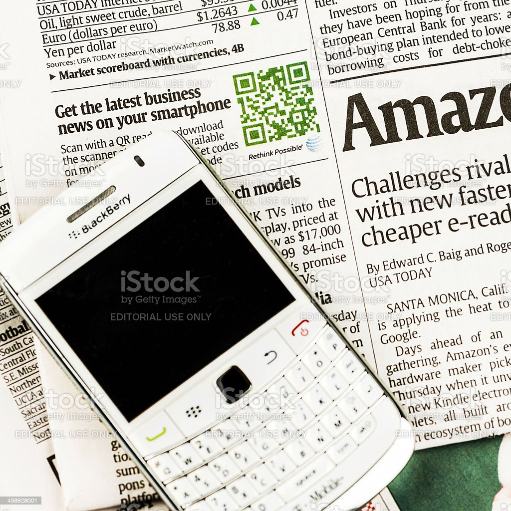 QR Code For Business News and Blackberry Bold Mobile Phone royalty-free stock photo
