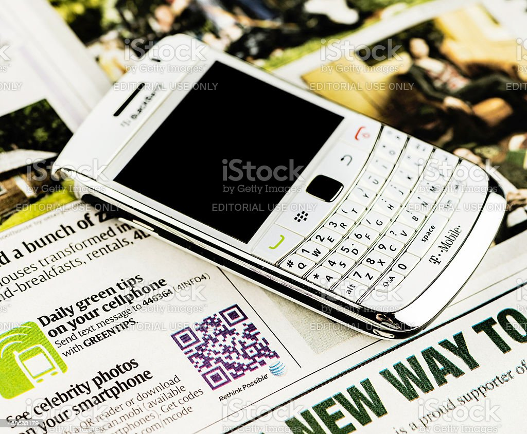 QR Code For Entertainment and Blackberry Bold Mobile Phone royalty-free stock photo