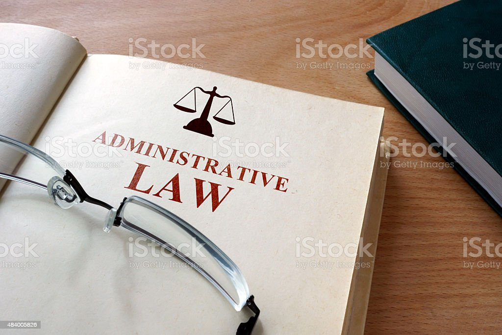 Code of   administrative law on a wooden table. stock photo