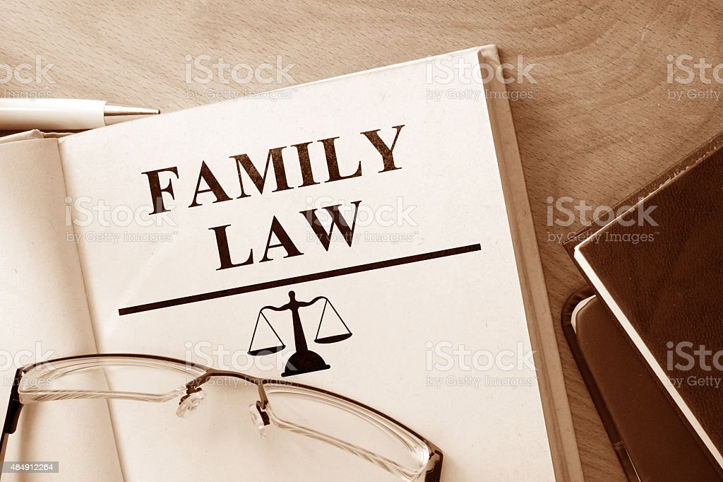 Code of  family law on a wooden table. stock photo