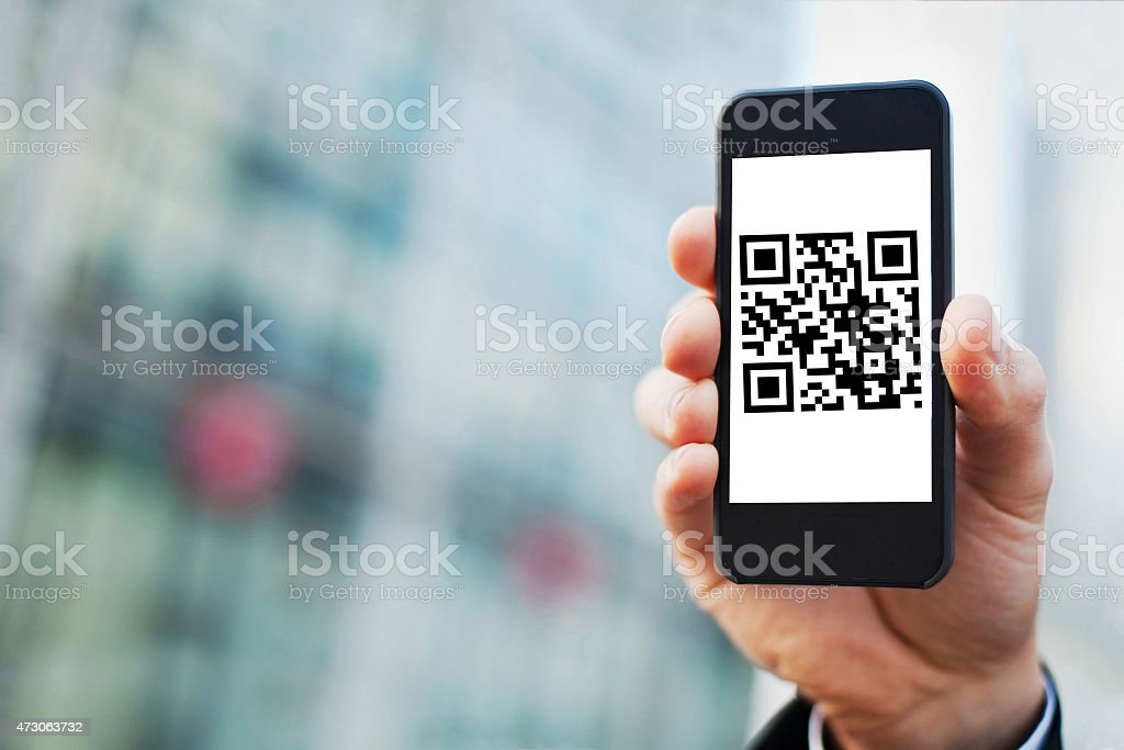 QR code on the screen of smart phone stock photo