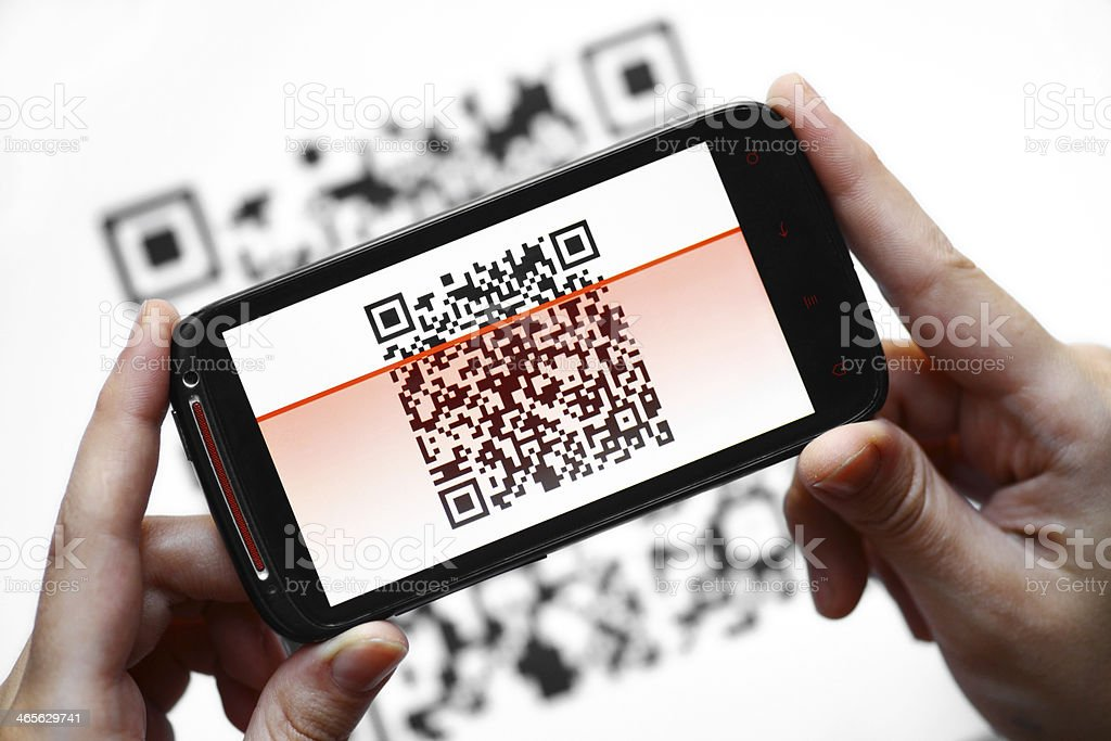 QR code reader demonstrated on hand-held smart phone stock photo