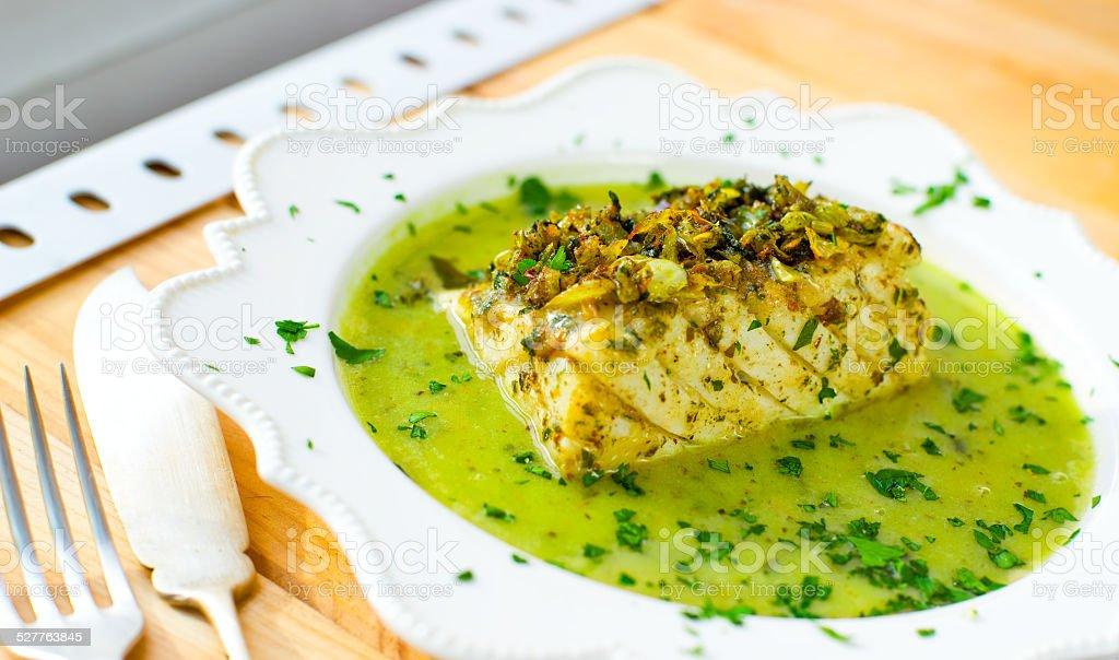 Codfish in green sauce. stock photo