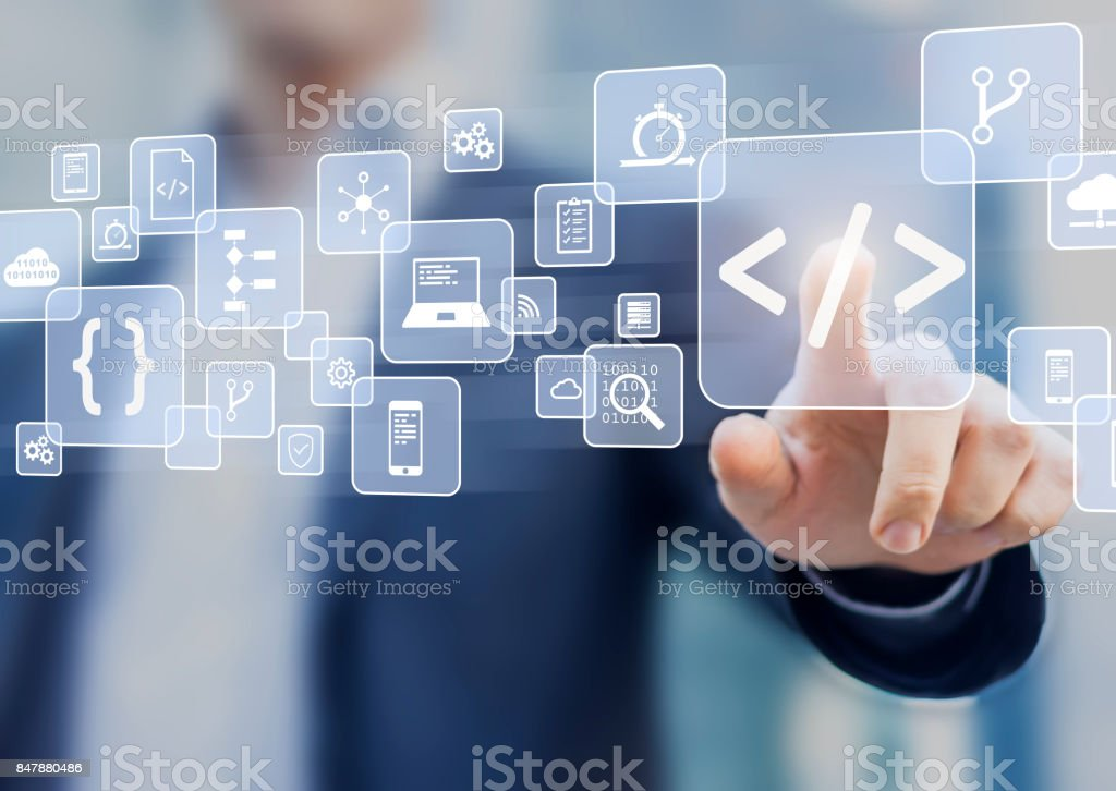 Coding concept with software developer touching code symbol and icons stock photo