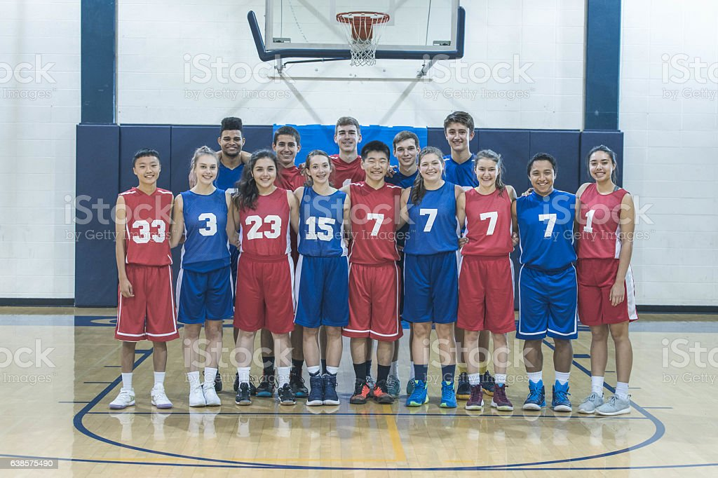 Co-ed  group of high school basketball players in stock photo