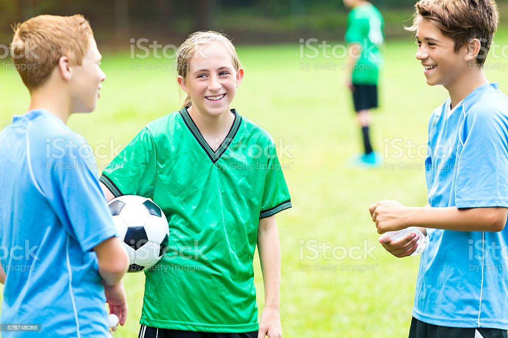 Coed soocer players talk before game stock photo