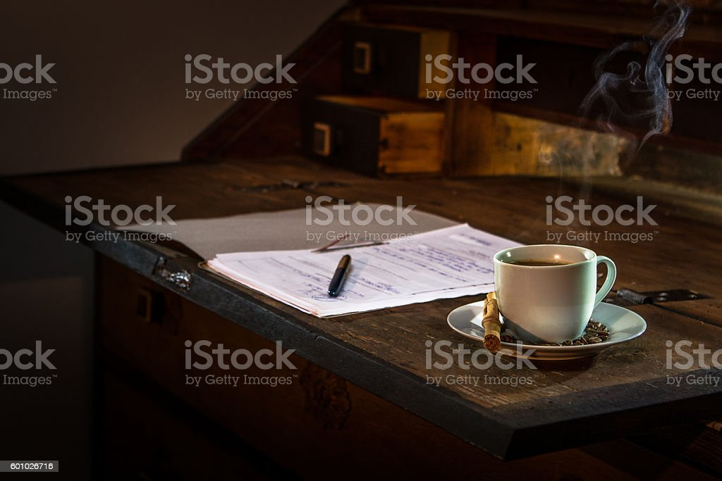Cofee and papers on a wood table stock photo