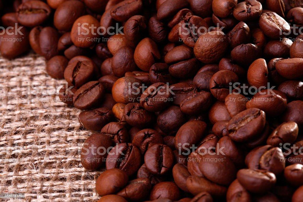 Cofee beans on burlap stock photo