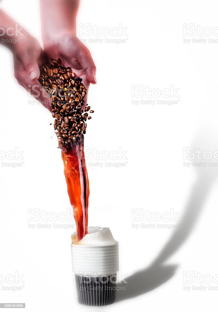 Coffe beans poured from a hand transformes to coffe stock photo