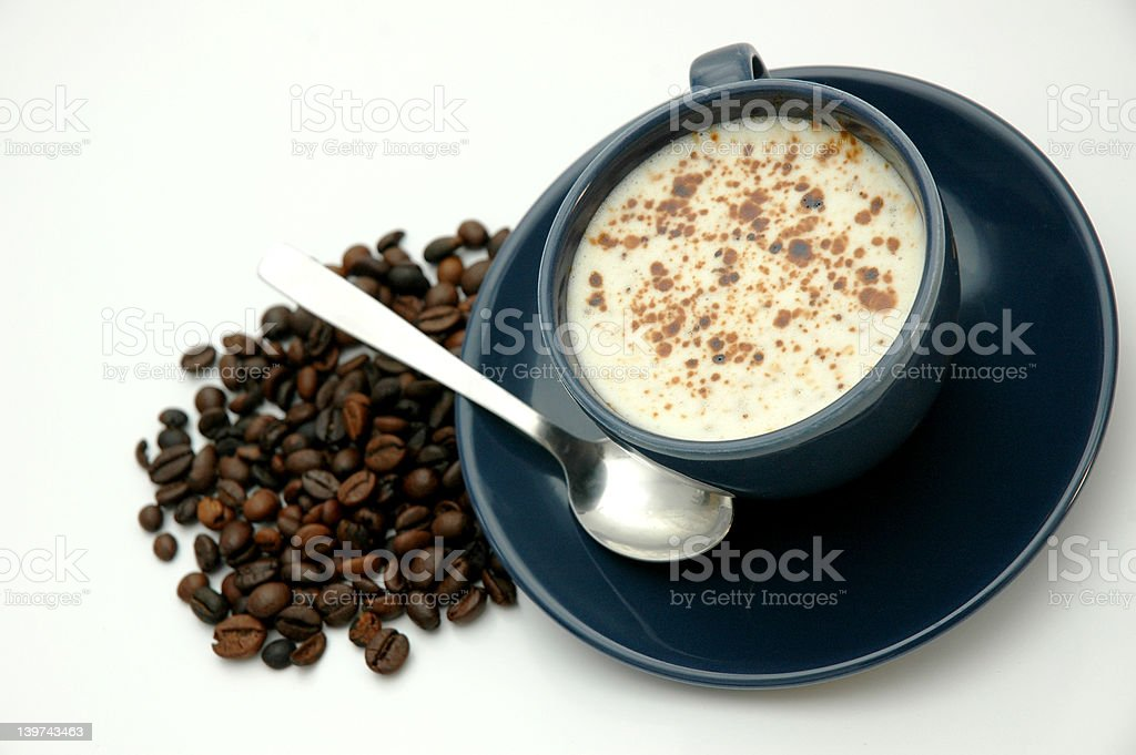 Coffe cup and beans royalty-free stock photo