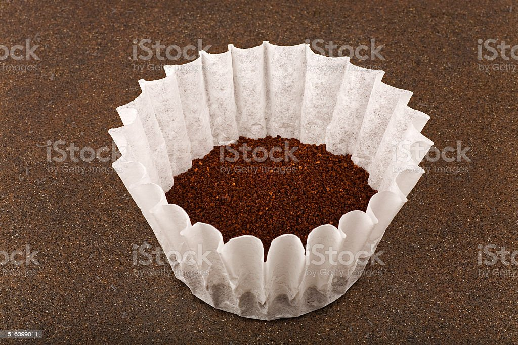 coffe filter with ground coffee stock photo