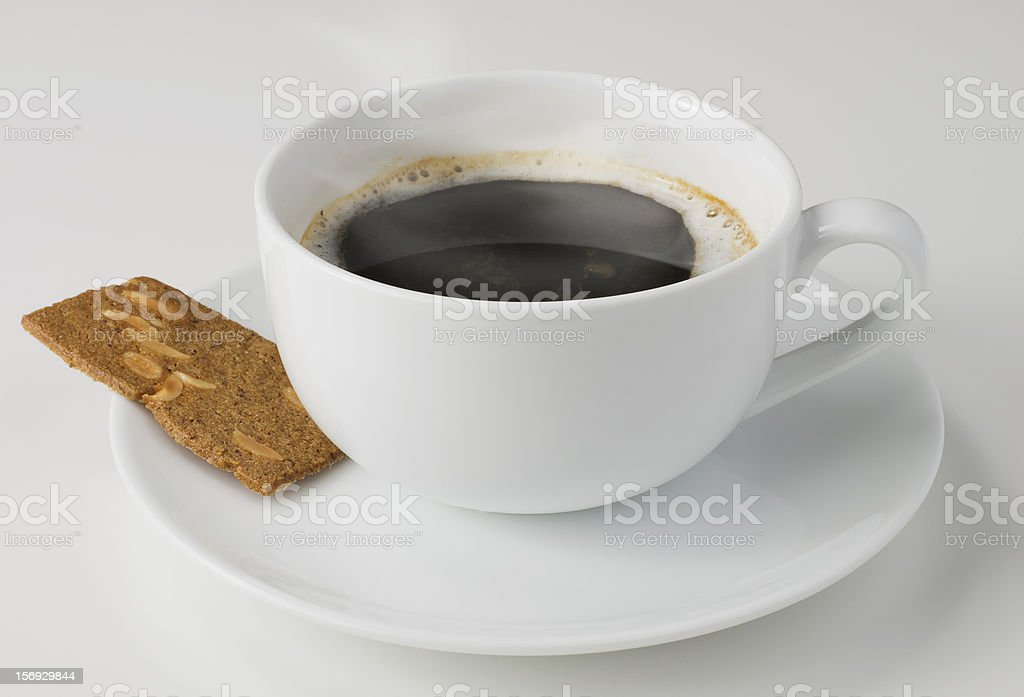 Coffee and a biscuit stock photo