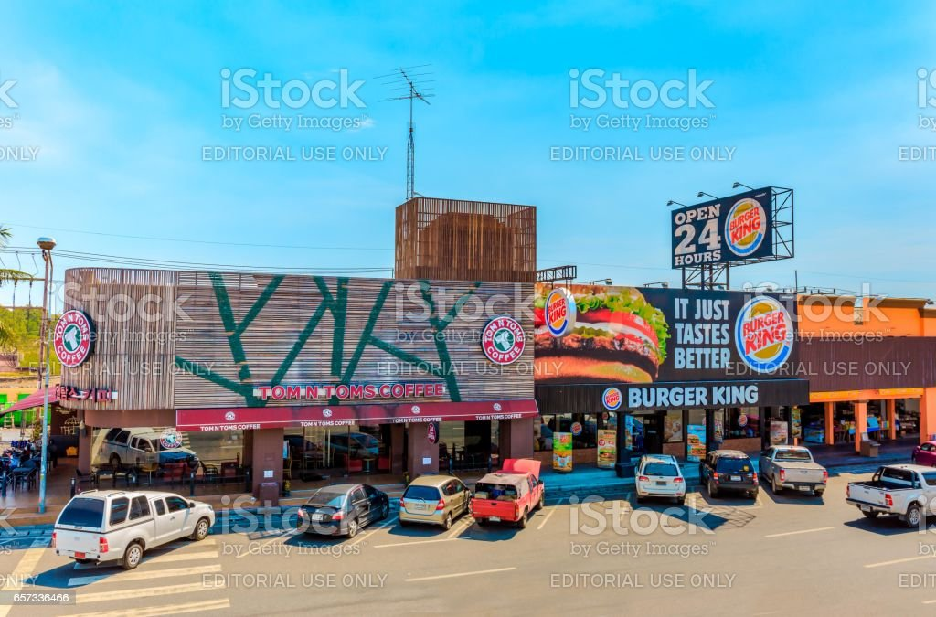 CHONBURI, THAILAND- MARCH 22, 2017 : TOM N TOMS Coffee and BURGER KING at Motorway Rest Area where located middle way to PATTAYA town. It is the good place for tourist when want to find some drink. stock photo