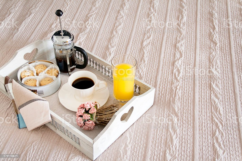 Coffee and cakes on a tray with flowers stock photo