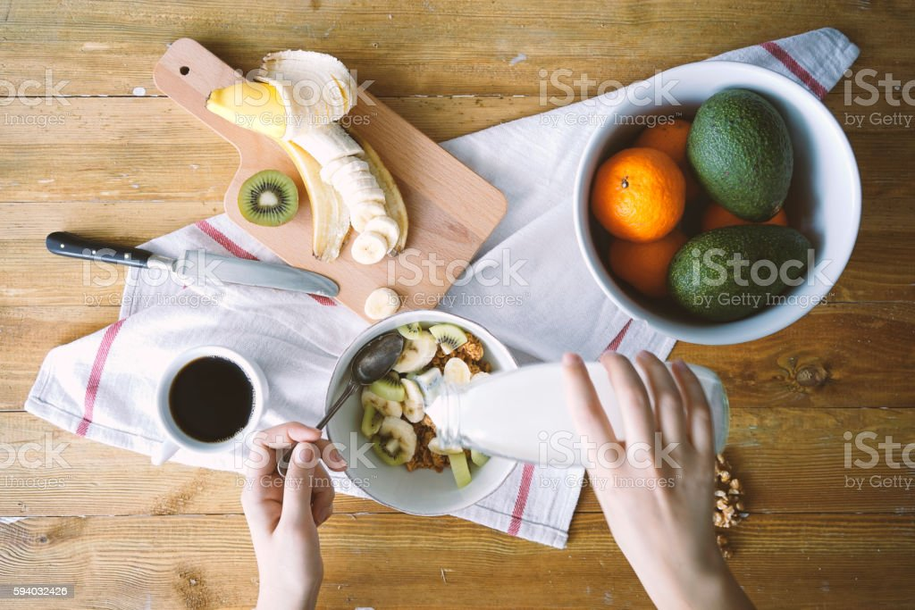 Coffee and cereal with fresh fruits for breakfast stock photo