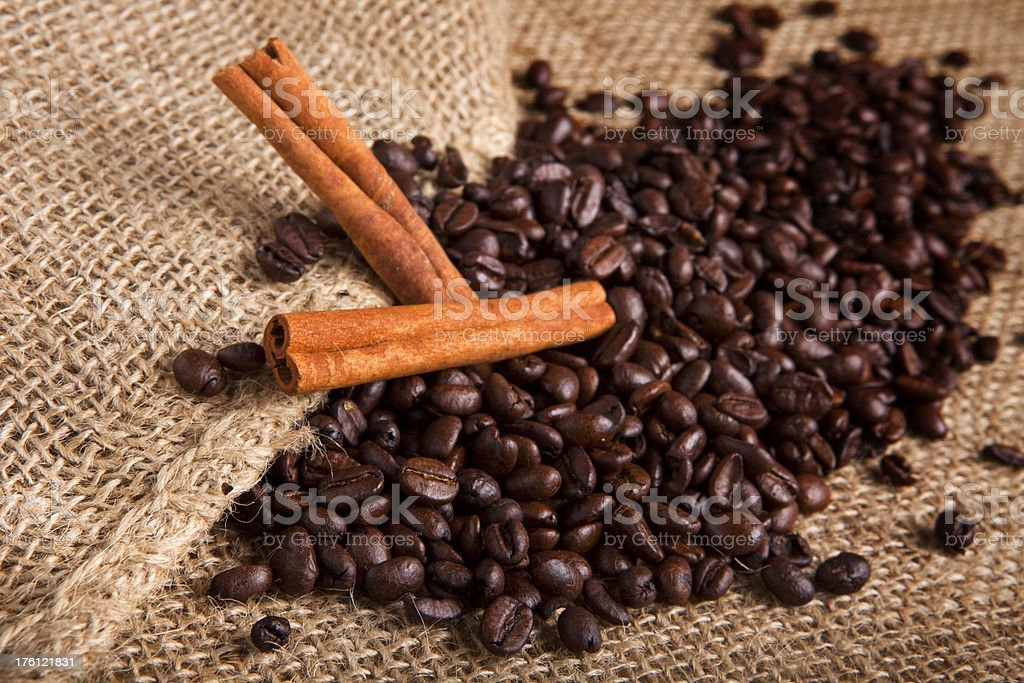 Coffee and cinnamon on a burlap cloth royalty-free stock photo