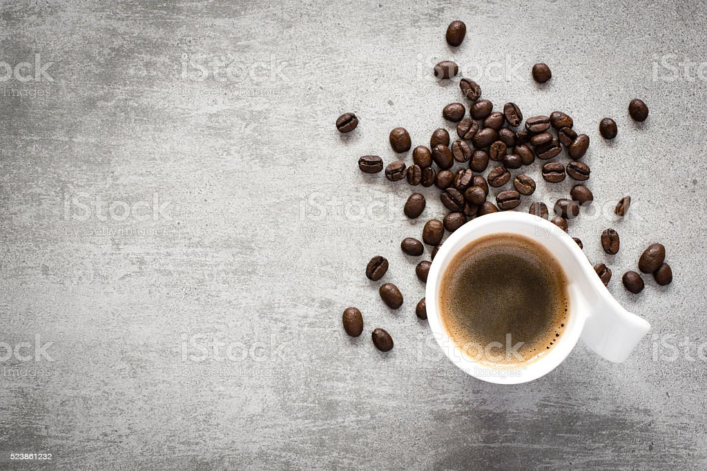 Coffee and coffee beans on a concrete table stock photo