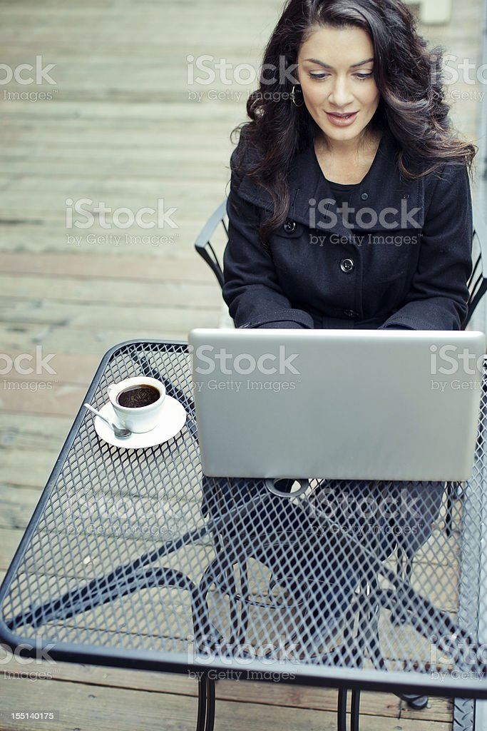 Coffee and Computer Business Woman Outdoors royalty-free stock photo