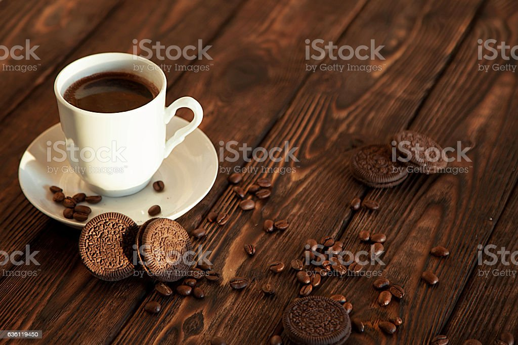 coffee and cookies on a wooden table royalty-free stock photo