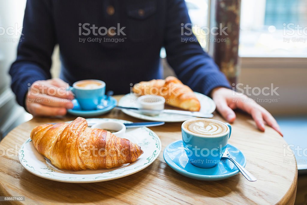 Coffee and croissant. French breakfast for two (Paris, France) stock photo