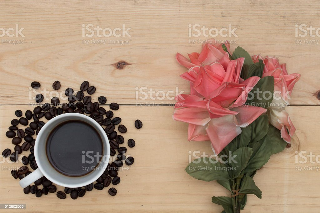coffee and flowers on wood table. stock photo