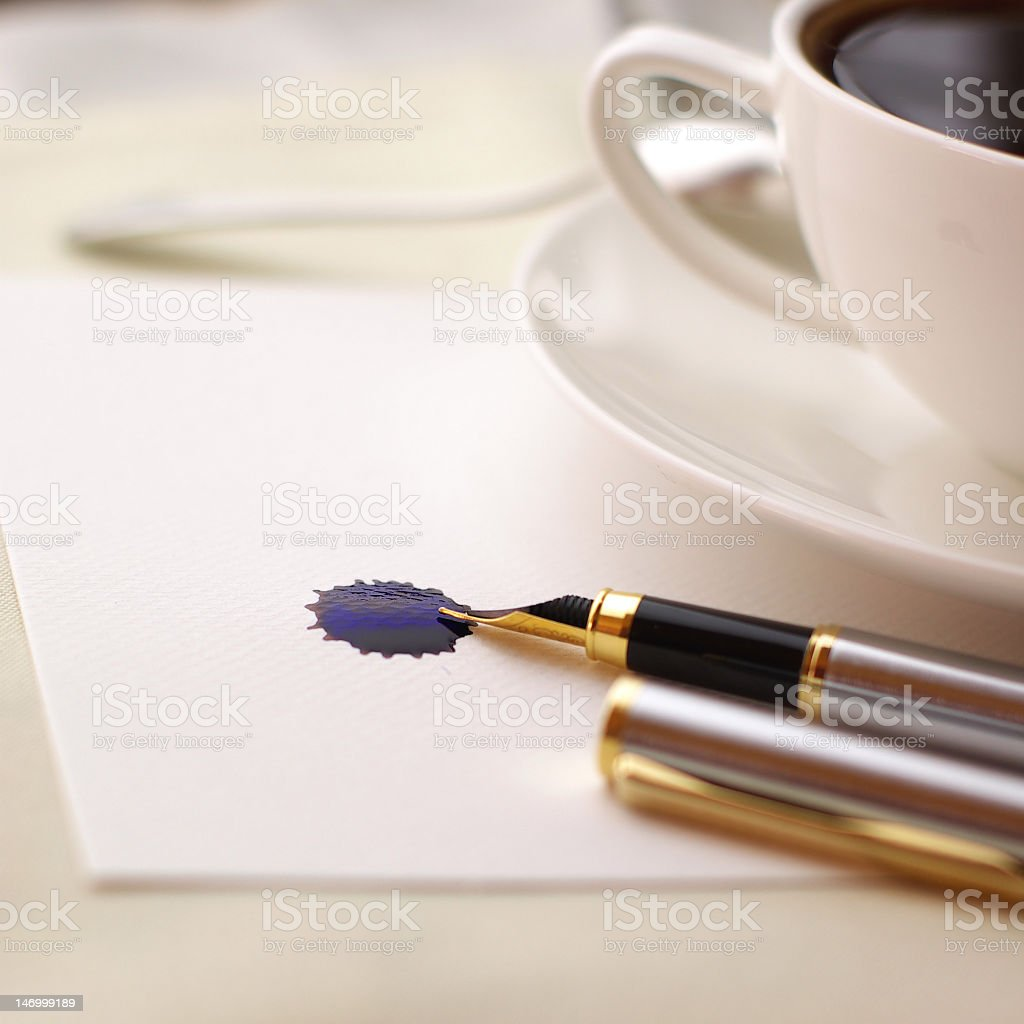 Coffee and fountain pen royalty-free stock photo