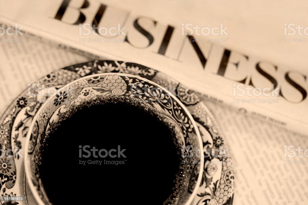 Coffee and Newspaper in Sepia Tone royalty-free stock photo