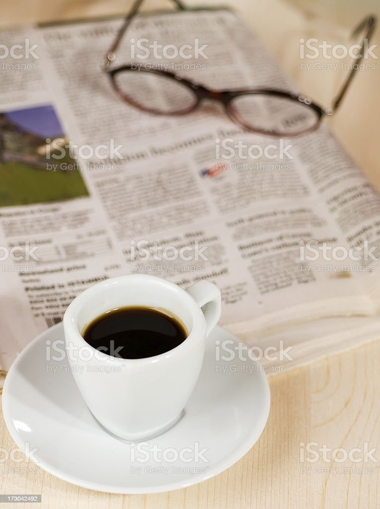Coffee and newspaper royalty-free stock photo