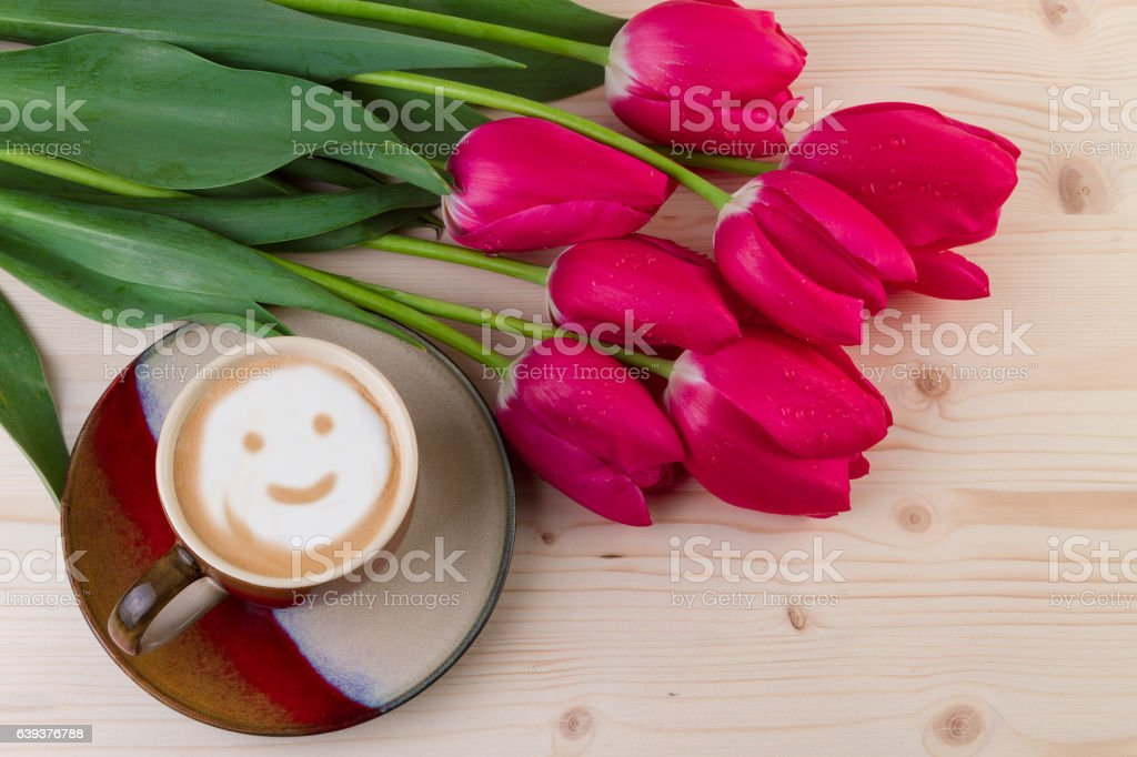 Coffee and red tulips on wooden background stock photo