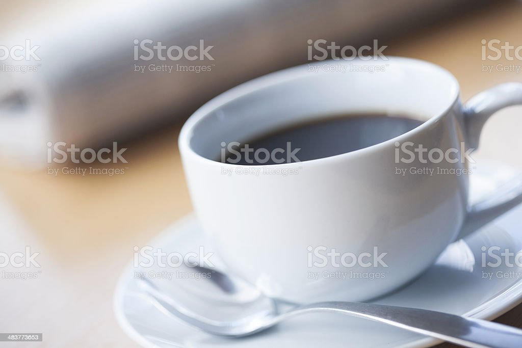 Coffee and Spoon with Newspaper royalty-free stock photo