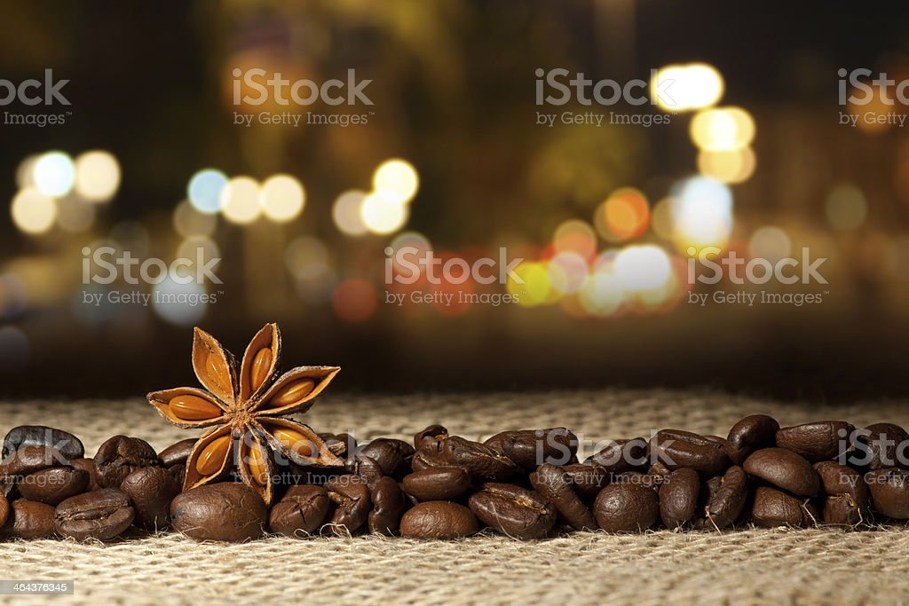 Coffee and Star Anise on sackcloth in the night royalty-free stock photo