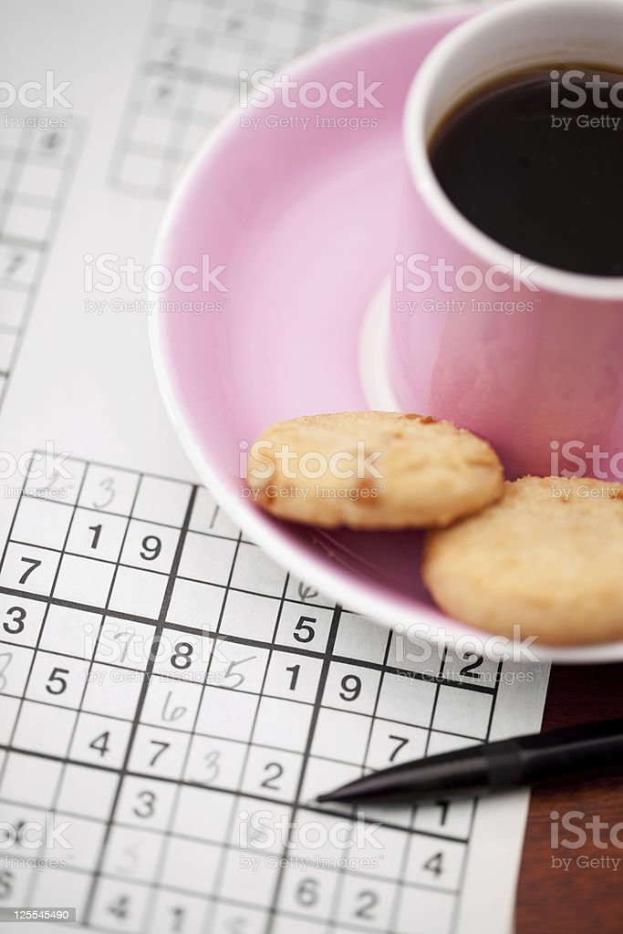 Coffee and Sudoku royalty-free stock photo