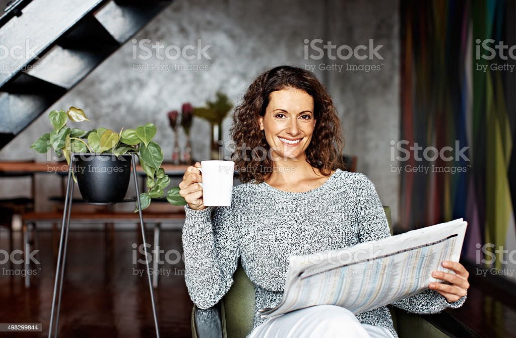 Coffee and the paper are part of my weekend routine stock photo