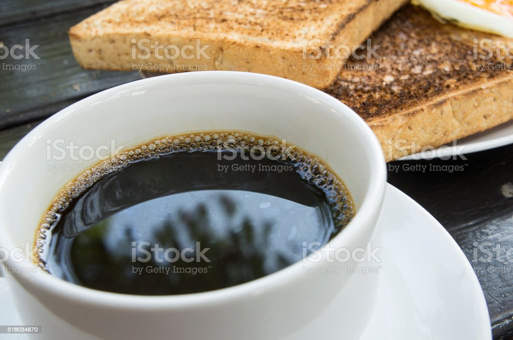 coffee and toast on the table stock photo